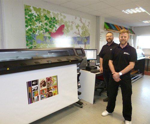 Robert and Aidan standing by the new machine