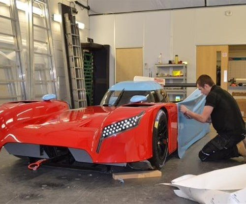Brandon Desborough in the process of wrapping the vehicle.