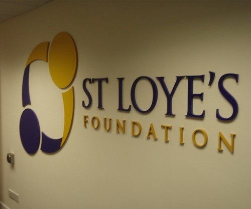 Cut vinyl logo for St Loyes College, applied direct to painted wall