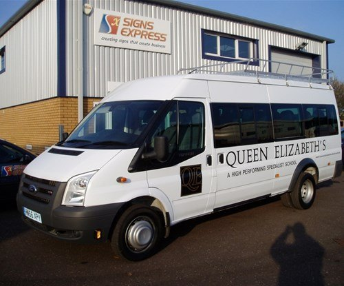 Simple, clear signwriting on School minibus for Queen Elizabeth's school