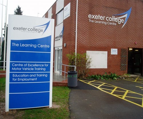 Curve faced totem sign (3m high, double-sided) and wall-mounted logo/lettering. Part of a project to re-brand all of Exeter College's sites