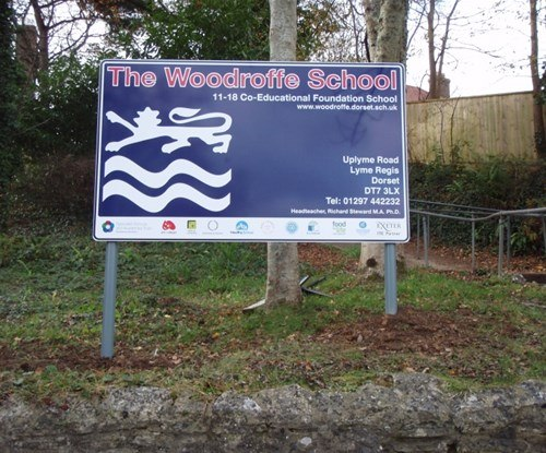 Main entrance sign for Woodroffe School - 3mm aluminium panel, mounted on posts into bank
