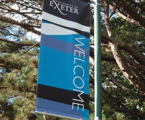 Lamp-post mounted banners for the University of Exeter - heavy-duty, digitally printed materials with tensioning wires to ensure they remain taut and resist the elements