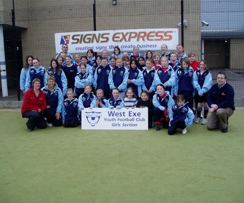 The West Exe Ladies football squad resplendent in their Signs Express training jackets