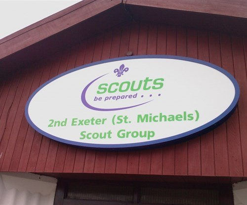 A surplus bespoke oval sign donated to 2nd Exeter Scout Group