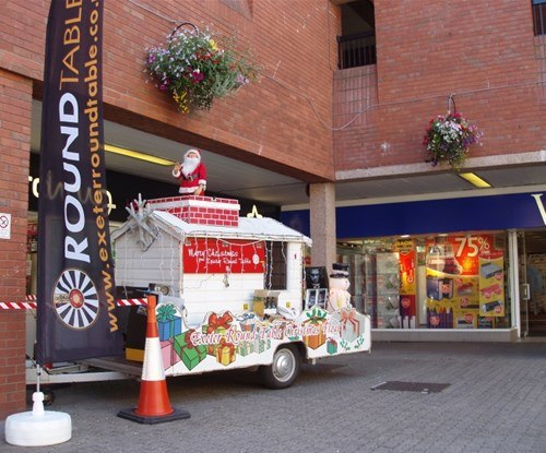 Promotional flags and Christmas themed graphics on display in Exeter's Guildhall Shopping Centre (in August!)