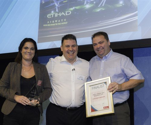 From left to right: Tina Surface, Craig Brown and Tony Surface with the award