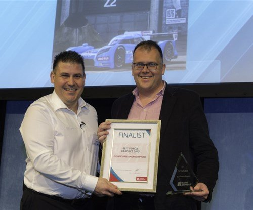 Craig Brown (left) and Mark Meadowcroft (right) receiving his award