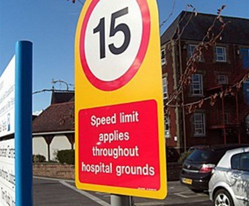 Hospital speed limit road sign