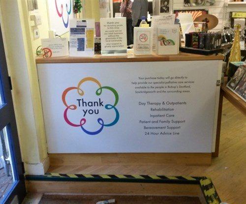 Internal cash desk graphics at Bishops Stortford