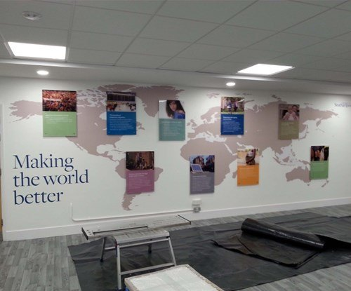 a combo of wall graphics and stand off signage brighten up the space