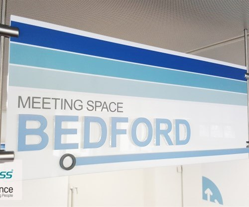 Acrylic hanging sign with flush bonded acrylic letters to face