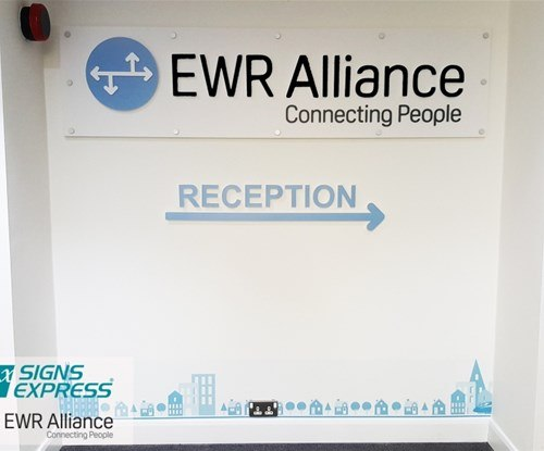 Lobby sign with digitally printed board to the bottom of the wall and stand off letters