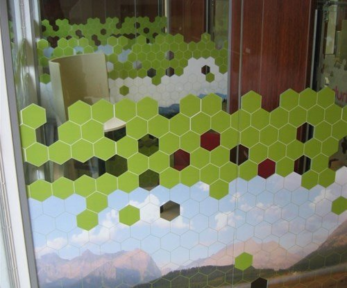 The double sided graphics incorporated a full colour hillside scene with vector shaped grass and honey combs. The images were The images were 3m wide by 1800mm high and the file was split into 5 separate panels.
