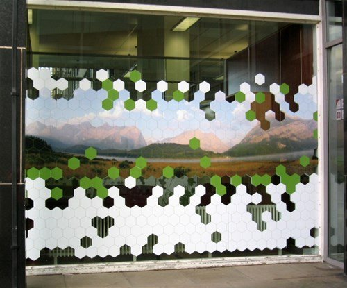 The double sided graphics incorporated a full colour hillside scene with vector shaped grass and honey combs. The images were The images were 3m wide by 1800mm high and the file was split into 5 separate panels