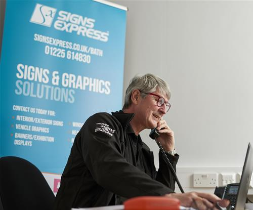 Mark Collins, Signs Express Bath Owner Speaking to Customers