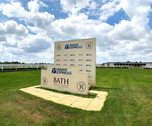 Winners' Podium with branded ACM signs for Bath Racecourse