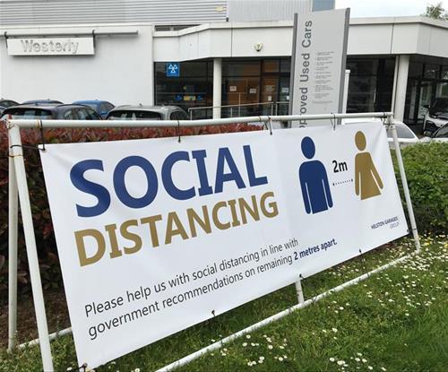 Outdoor banner to encourage social distancing