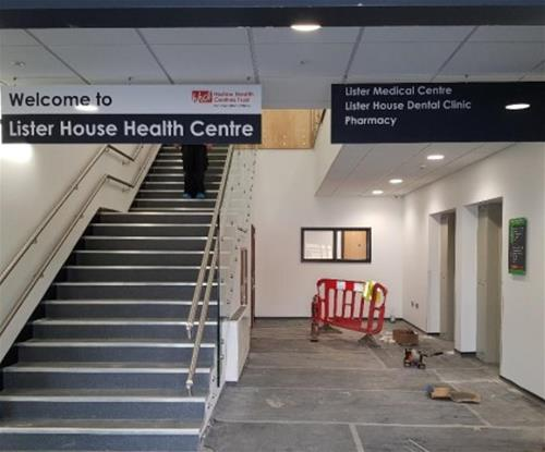 Hanging directional signs within centre lobby