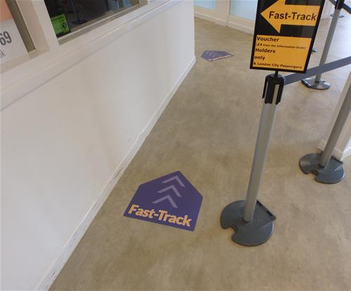 Exeter Airport floor graphics and queue management barrier