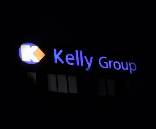 Illuminated face lit logo and name of Kelly Group