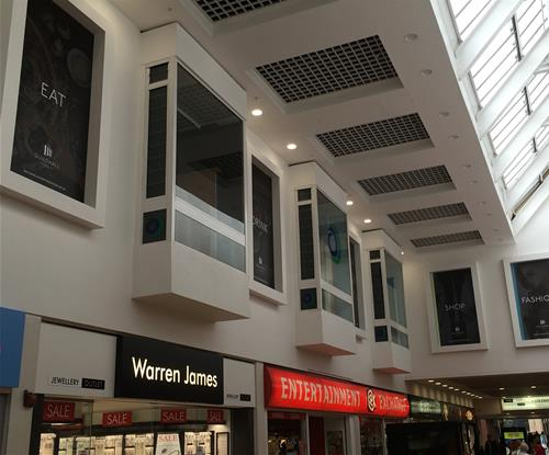 Sign panels with full colour digital print as part of atmospheric signage for shopping centre.