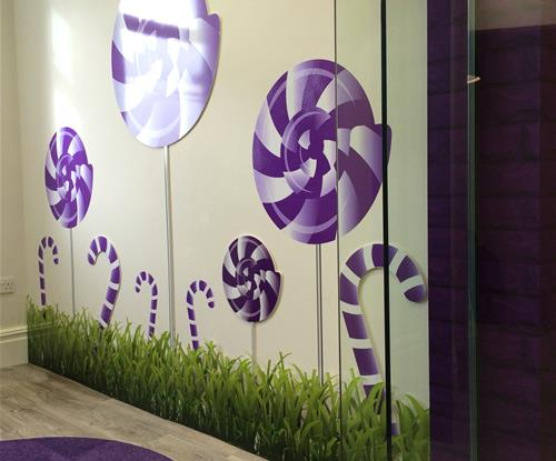 Feature wall with white acrylic and full colour printed vinyls applied