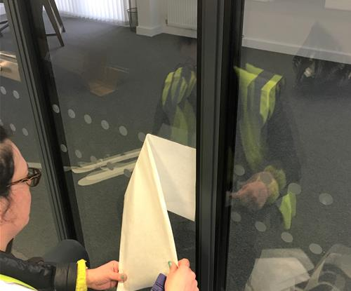 Manifestation Dots being applied to meeting room windows