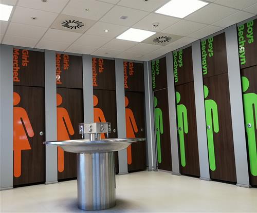 Self-adhesive vinyl applied to toilet cubicle doors