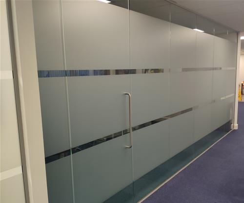 Etched effect window graphics for privacy in meeting room