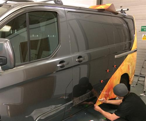 Vinyl application in the Signs Express Scarborough vehicle bay