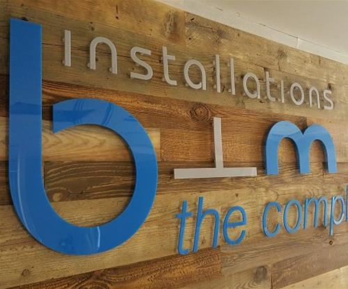 Industrial style signage with wooden back-board and flat-cut letters