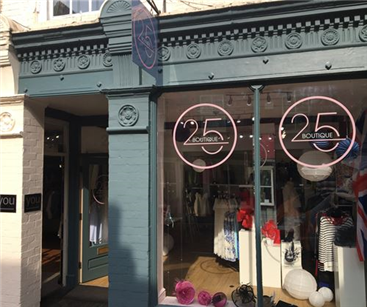 25 Boutique hanging sign and window graphics