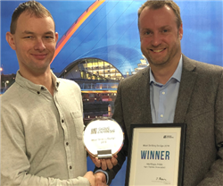 Adam Greaves (Left) accepts his award from Jonathan Bean (Right)