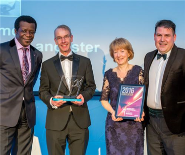 Thomas and Anne Somers receiving their award
