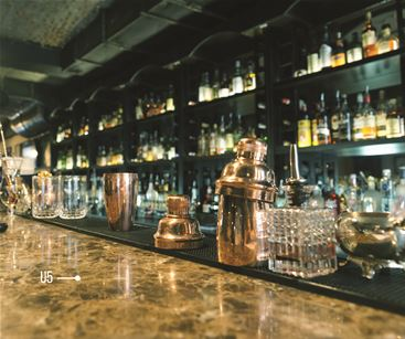 Architectural finishes to create marble effect bar