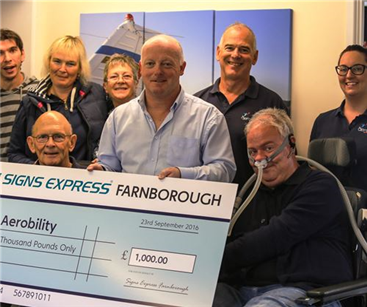 The team at Aerobility receiving the cheque