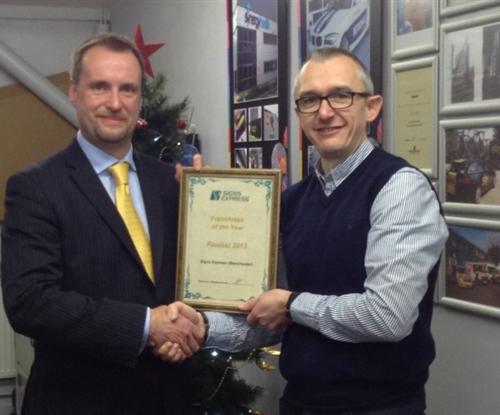 Finance director Jonathan Bean presenting award certificate to Lee Eaton