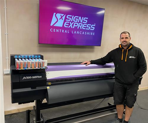 Paul Morris, Sign Maker stands next to new JV300-160 Plus