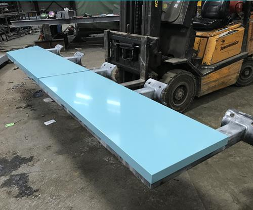 Powder coated trrays & frame being prepared in the workshop