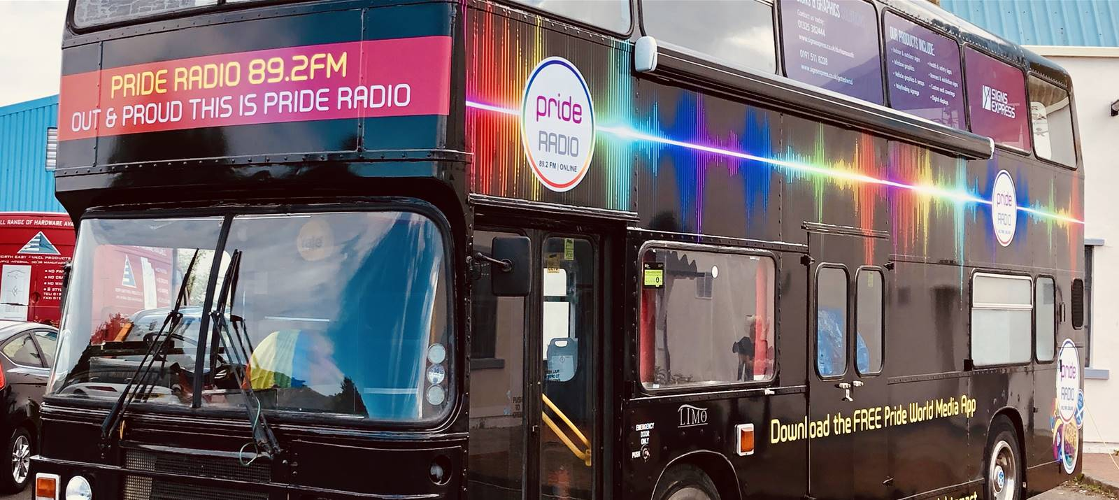 Pride Radio bus graphics from Signs Express