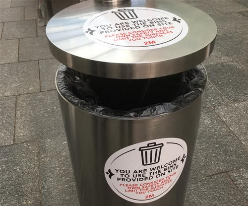 Graphics applied to bin with health and hygiene information