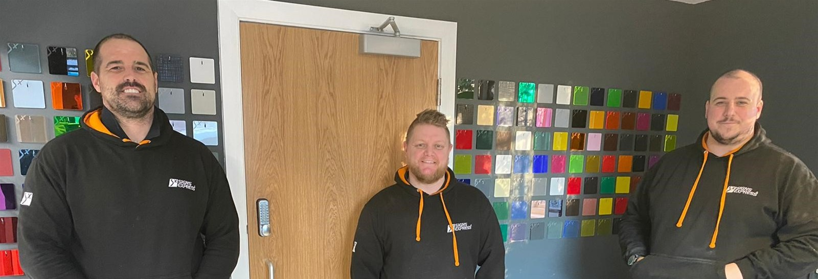 Paul, Dan and Rob pass their IPAF and PASMA qualifications - Stood in new Signage Unit in front of Perspex Acrylic Sample Wall