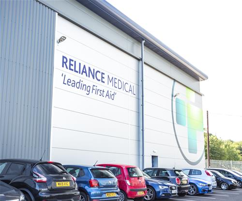 Reliance Medical Logo and Tagline on the Building from the Other Side