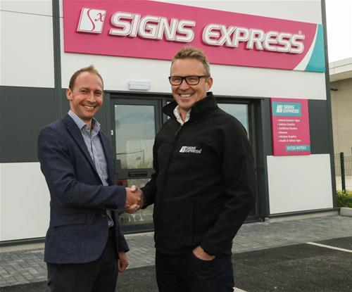 Aaron Davis, Signs Express Network Development Director (Left) Welcoming  Rod Clark, Owner of Signs Express (Salisbury) (Right)
