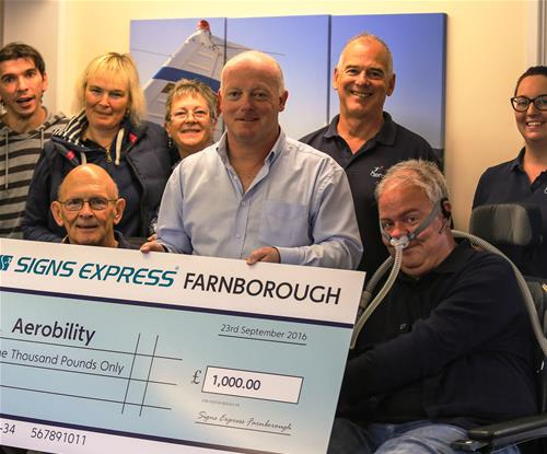 Front Row - Brian Catchpoole (Operations Manager, Aerobility), Tim Burt (Centre Owner, Signs Express Farnborough), Mike Miller-Smith (Chief Executive, Aerobility)