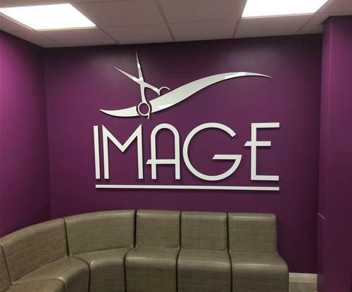 Manufactured in-house and installed the sign which consisted of cut out letters and a scissor design from white acrylic