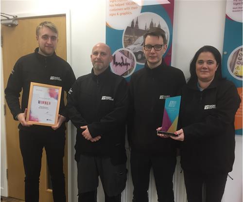 The team at Signs Express Basildon receiving their award