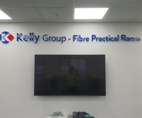 Training room wall mounted acrylic lettering fitted on stand off locator fixings.