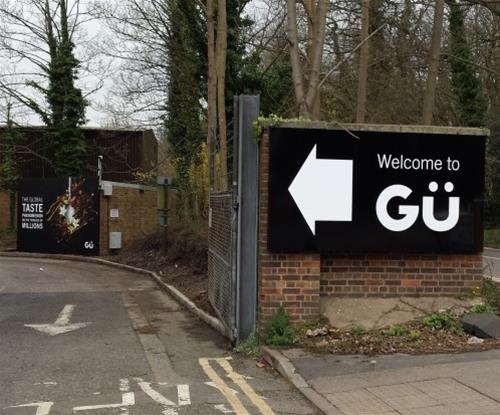 2.7metre tray sign directing to Gü factory and offices from Dunmow Road